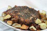 Porco assado com ervas e batatas